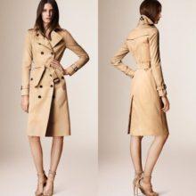 На фото модное женское пальто тренч